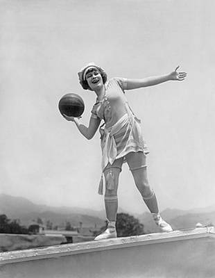 Photograph - Flapper Playing Basketball by Underwood Archives