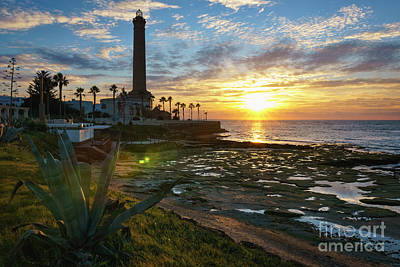 Photograph - Flaring Sun At Chipiona Lighthouse Cadiz Spain by Pablo Avanzini