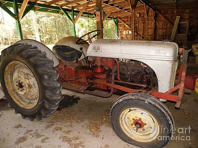 Photograph - Flat Tire On The Ford Tractor by D Hackett
