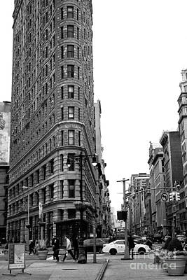 Photograph - Flatiron Walking by John Rizzuto