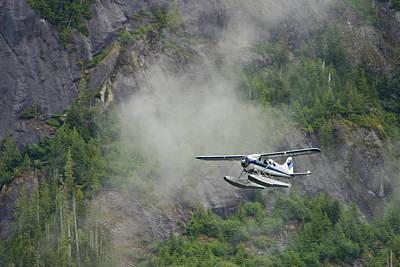 Float Plane Photograph - Float Plane Against Granite Cliff by Ralph Lee Hopkins