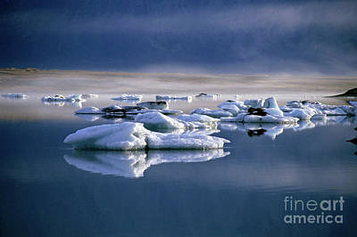 Floating Icebergs Reflected In The Quiet Waters Of Jokulsarlon Art Print by Sami Sarkis