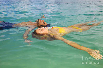 Floating Young Couple Art Print by Tomas del Amo - Printscapes