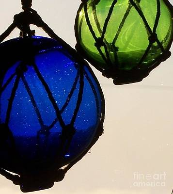 Photograph - Floats by Jackie Mueller-Jones