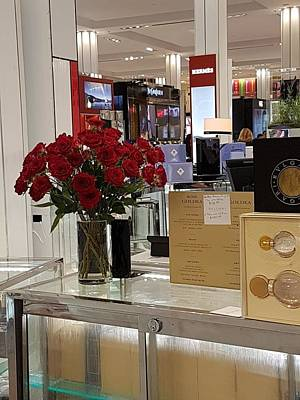 Photograph - flowers in Macy's by Lali Partsvania