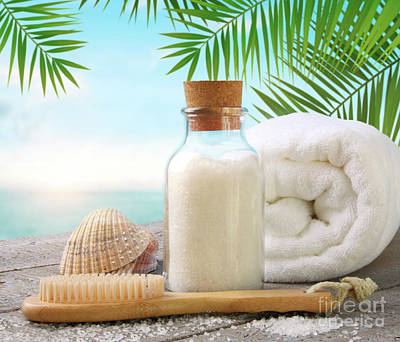 Photograph - Fluffy Towels With Sea Salt And Seashells On Beach Table by Sandra Cunningham