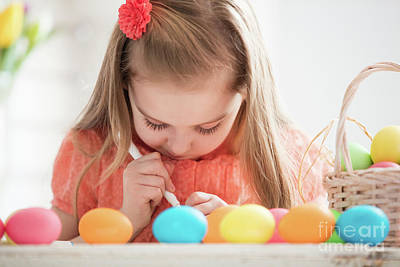 Photograph - Focused Child Creating Drawings On Colorful Dyed Eggs by Michal Bednarek