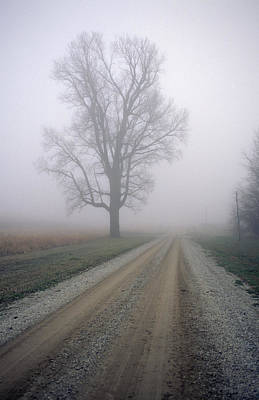 Gravel Road Photograph - Fog Moves In On A Gravel Country Road by Joel Sartore