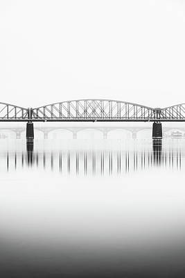 Photograph - Foggy Winter Mood At Vltava River. Reflection Of Bridges In Water. Black And White Atmosphere, Prague, Czech Republic by Marek Kijevsky