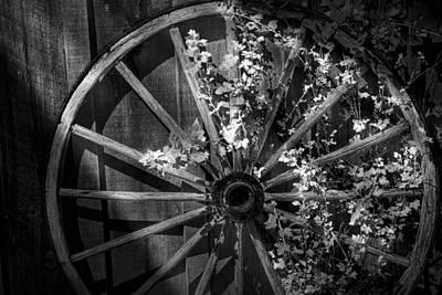 Wagon Wheel Hub Wall Art - Photograph - Foliage Overgrown Wagon Wheel In Black And White by Randall Nyhof