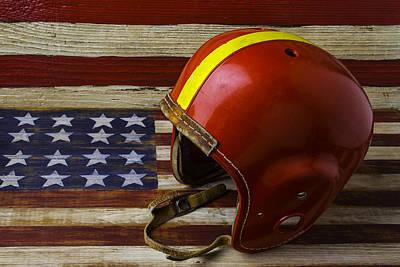 Football Helmet On American Flag Art Print by Garry Gay