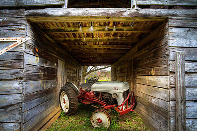 Photograph - Ford Tractor Hiding In The Barn by Debra and Dave Vanderlaan