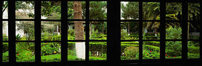 Grid Photograph - Formal Garden Viewed Through A Window by Panoramic Images