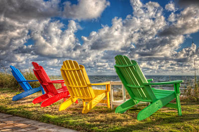 Four Chairs At The Beach Art Print by Debra and Dave Vanderlaan
