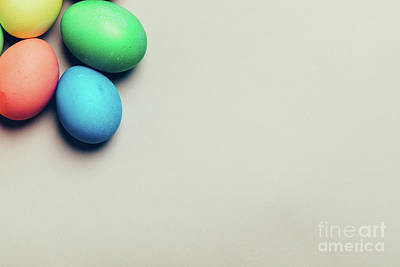 Photograph - Four Colored Eggs In A Corner On Creamy Background by Michal Bednarek