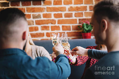 Photograph - Four People Raising Glasses To Toast. by Michal Bednarek