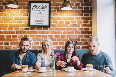 Photograph - Four People Sitting At The Table In A Cafe by Michal Bednarek