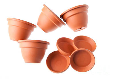 Mess Photograph - Four Scattered Clay Flowerpots With Saucers  by Arletta Cwalina
