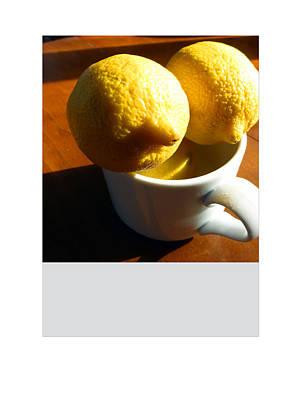 Framed Lemons And White Cup Art Print