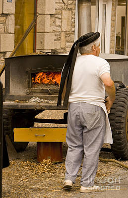 French Baker Prepares His Wood Buring Oven For Baking Bread Original