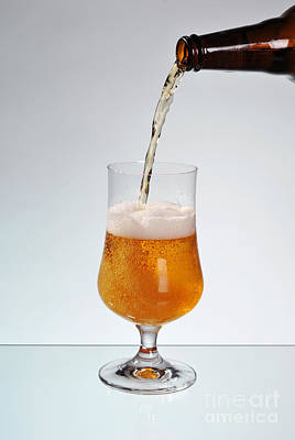 Beer Royalty-Free and Rights-Managed Images - Fresh beer filling glass on stem  by Arletta Cwalina