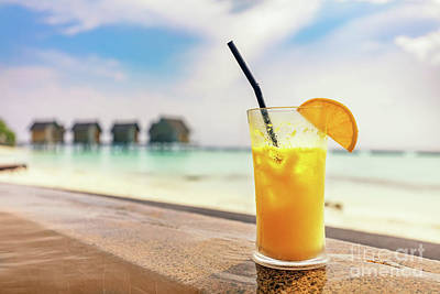 Photograph - Fresh Orange Juice By The Poolside. Tropical Island In Maldives by Michal Bednarek