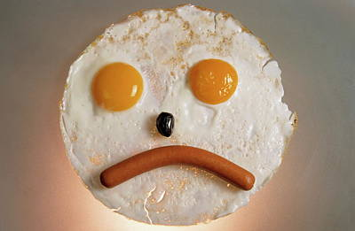 Fried Breakfast Of Eggs And Sausage Made Into A Frowning Face Art Print by Sami Sarkis