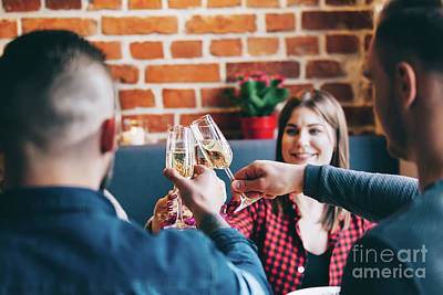 Photograph - Friends Toasting Together In A Restaurant, by Michal Bednarek