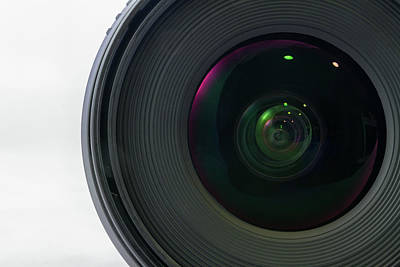 Background Photograph - Front View Of Black Camera Lens Isolated On White Background by Iordanis Pallikaras