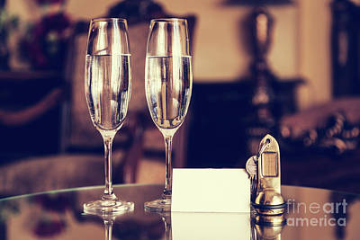 Indoors Photograph - Full Champagne Glasses, Antique Keys And Blank White Card. Luxury Hotel Apartment by Michal Bednarek