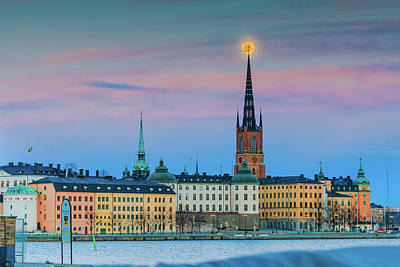 Photograph - Full Moon Rising Over The Riddarholmen Church In Stockholm Old City During Sunset by Dejan Kostic