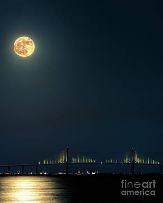 Photograph - Full Moon Rising Over The Sunshine Skyway Bridge by Damon Powers
