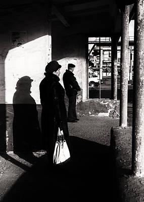 Photograph - Fur Hat Woman Waiting At Bus Stop by John Williams