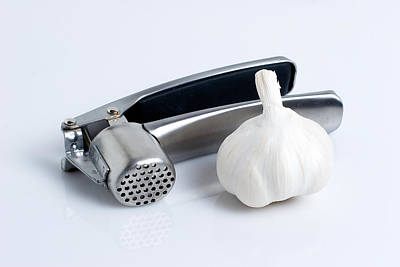 Kitchen Photograph - Garlic Press With Garlic by Tom Mc Nemar