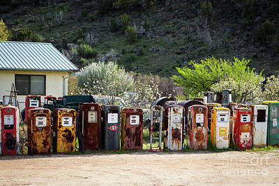Photograph - Antique Gas Pumps All In A Row by Sabrina L Ryan