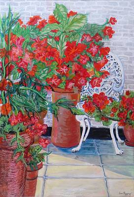 Geraniums And Petunias On The Terrace Art Print by Joan Thewsey