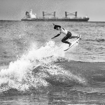 Surfing Photograph - Getting Some Air by Russ Dixon