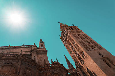 Photograph - La Giralda Bell Tower Brilliantly Lit In Teal And Orange by Georgia Mizuleva
