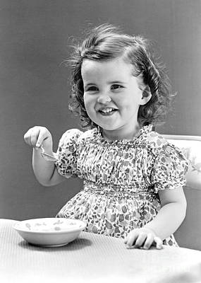 Girl Eating Ice Cream, C.1940-30s Art Print by H. Armstrong Roberts/ClassicStock