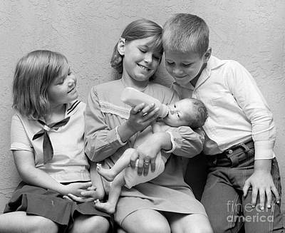 Four Sisters Photograph - Girl Feeding Baby Sister, C.1970s by H. Armstrong Roberts/ClassicStock