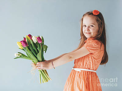 Celebrity Watercolors - Girl holding a bunch of colorful tulips. by Michal Bednarek