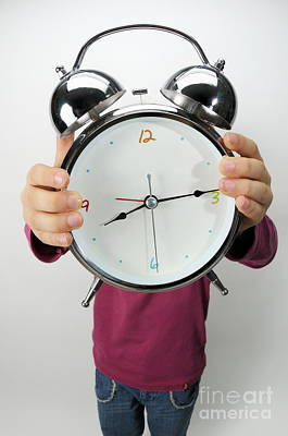 Obscured Face Photograph - Girl Holding Alarm Clock Over Face by Sami Sarkis