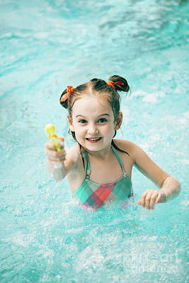 Photograph - Girl In A Swimming Pool With A Water Pistol by Michal Bednarek