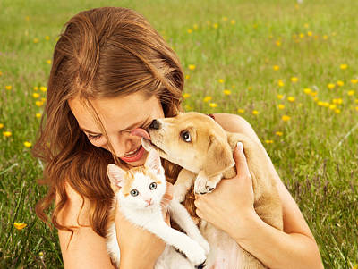Candid Photograph - Girl In Field With Kitten And Affectionate Puppy by Susan Schmitz