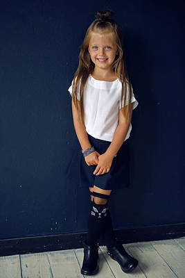 Bear Photography Rights Managed Images - Girl In White Shirt Posing In The Studio Royalty-Free Image by Elena Saulich