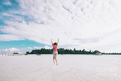 Photograph - Girl Jumping On A Sandy Beach. Fun Time On Maldives by Michal Bednarek
