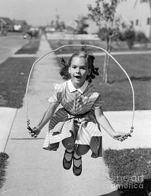 Girl Jumping Rope On Sidewalk, C.1950s Art Print by Debrocke/ClassicStock