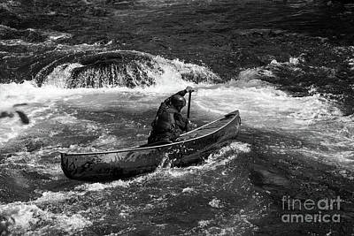 Photograph - Girl Paddling An Open Canoe In Rapids by Les Palenik