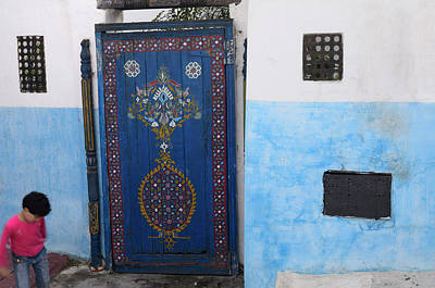 Rabat Photograph - Girl Playing At Painted Blue Door In An Alley Of Oudaia Kasbah R by Reimar Gaertner