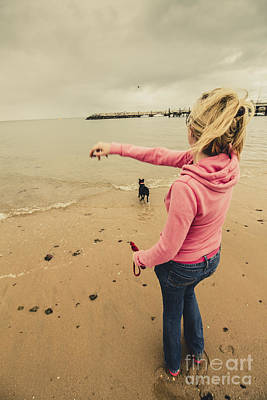 Girl Playing Fetch On Overcast Day Art Print by Jorgo Photography - Wall Art Gallery